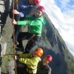 Children climbing on the via ferrata course at Honister in the Lake District
